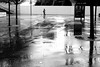 On the still wet place (pascalcolin1) Tags: paris13 austerlitz pluie rain reflets reflection femme place woman square wet humide photoderue streetview urbanarte noiretblanc blackandwhite photopascalcolin canon canon50mm 50mm