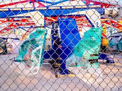 Wrapped for the Winter (deepaqua) Tags: brooklyn lunapark amusementpark offseason winter coneyisland fence
