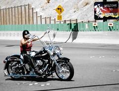 Leaving Nevada (Shot by Newman) Tags: harley woman biker bikeweek laughlinnevada riverrun shotbynewman fujifilm fuji400 35mm daylight old35mmminolta
