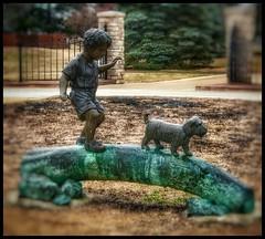 Frozen in time.... (Sherrianne100) Tags: frozen sculpture boyanddog nathanaelgreenepark springfieldmissouri missouri