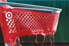 Red Hot Deals (Jetcraftsofa) Tags: nikonf3 nikkor5014 reala100 35mm slr filmphotography fujifilm melted plastic shoppingcart complementarycolors