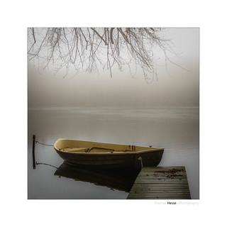 Boat on the fog lake