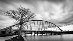 Winter Storm Front (darwinmacon) Tags: nikon d850 river water bridge blackandwhite bw lake longexposure clouds 10stop neutraldensity filter nisi nd1000 moving sky monochrome nikkor 1635mmf4