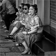 Fruity delight (John Riper) Tags: johnriper street photography straatfotografie square vierkant bw black white zwartwit mono monochrome bangkok thailand candid john riper xt2 fujifilm asi asian ladies girls fruit snacking delight sitting relaxed sunglasses