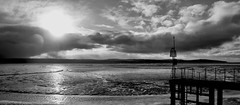 Clouds breaking up across Wales from West Kirby lake (jimmedia) Tags: sea mountain hills water coast wales hill panoramic seaside current jetty look out wirral landscape view clouds sunshone sunset coastline sand merseyside