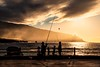 Sunset Fishing (galvanol) Tags: elhierro sunset volcanic water mood clouds fishermen canaries atlantic spain light island fish haze family galvanol sun elgolfo