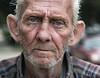 Baltimore (crabsandbeer (Kevin Moore)) Tags: event baltimore festival honfest people man portrait street candid hampden wizened eyes blueeyes face weathered wrinkles texture expression whiskers elderly bokeh dof person human character