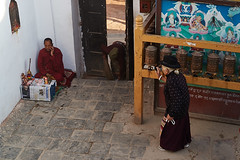 Old tibetan woman spinning prayer wheels, Boudhanath, Kathmandu, Nepal (Alex_Saurel) Tags: mobilephone sweeping tibetanoldwoman fresque tibetantibetanapron phoning pangden kora asie praying culture 35mmprint scans tibetantmonk asian buddhistmonk kasaya tibetanmonk moulinsàprière tibetanbuddhism motif moinebouddhiste pattern moinetibétain bouddhisme porte buddhism door sanctuary people khāsacaitya boudhanath kesa asia khāsti architecture travel sanctuairebouddhiste lifescene बौद्धनाथ imagetype buddhistsanctuary photospecs photoreport jarungkhashor photoreportage reportage kathmandu tibetanfresco bouddhanath fresco prayerwheel bodnath oldwoman byarungkhashor photojournalism main religion stockcategories hand day traditional time katmandou tradition nepal scènedevie lifestyles sony50mmf14sal50f14