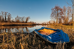 Fishing boat moored on the shore of the lake. (franco nadalin) Tags: boat craft creek fishing lake lakeside landscape leisure nature outdoors pond reeds river rural scene shore sky tranquil trees vessel view water wildlife