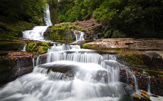 Mcleans falls in summer (Yani Dubin) Tags: d850 catlins widelens colour longexposure moss waterfall water southotago color gimp black green tamronsp1530mmf28divcusd mcleanfalls newzealand clutha summer red white nature river dim darktable landscape