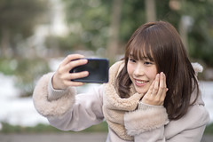 Young woman taking selfie picture in public park (Apricot Cafe) Tags: img80121 asia asianandindianethnicities canonef85mmf18usm healthylifestyle japan japaneseethnicity tokyojapan beginnings bonding candid carefree casualclothing charming cold colorimage copyspace day domesticlife family handonchin happiness hopeconcept lifestyles loveemotion mother newlife oneperson onlyjapanese outdoors people photographing photography pregnant publicpark realpeople relaxation selectivefocus selfie smartphone smiling straighthair sustainablelifestyle toothysmile waistup wife winter women youngadult