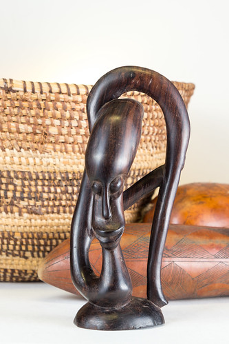 Hand Carved Vintage Africian Woman with Basket in Background