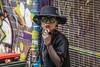Lady Melbourne (stenaake) Tags: lady people face smoking cigarette graffiti street melbourne hat victoria australia oz downunder streetphotography city town portrait woman sunglasses glasses