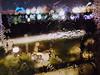 ice bridge night (boxerrod) Tags: windows night nighttimephotography streetphotography ice snow lights street lookingdown blue dark lookingthroughawindow window door wet cold illusion optical bridge road houston city park blurrry color snowday image