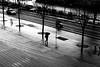 At the bottom of steps (pascalcolin1) Tags: paris13 bnf femme woman parapluie umbrella pluie rain reflets reflection marches steps photoderue streetview urbanarte noiretblanc blackandwhite photopascalcolin 50mm canon50mm canon
