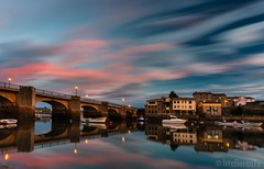 November Colors (IrreBerenTe Natalia Aguado) Tags: explore pastel soft fish travel clouds sky reflections reflects nightphotography night sea citylandscape longexposure landscape fishingboats boats houses bridge travelspain villasmarineras cantabria sanvicentedelabarquera colors nataliaaguadoirreberente
