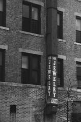 14K Jewelry, 4th Ave at 34th Street, Brooklyn (josephkrings) Tags: brooklyn kodak nyc nikkor28105mm13545 nikonn70 sunsetpark tmax400 blackandwhite monochrome sign street