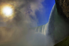 Niagara Falls : Side view . . . (Clement Tang **busy**) Tags: travel nature nationalgeographic canada southontario autumnmorning scenicsnotjustlandscapes concordians closetonature sidelit backlit sunbehindmist cplfilter landscape riverscape niagarariver niagarafalls journeybehindthefalls horseshoefalls handheldhdr sunglare bluesky grandemaregroup waterscape
