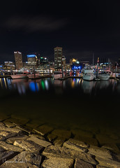 Shore Of The City (SpencerTheCookePhotography) Tags: city night longexposure water shore bay baltimore maryland boat bulidings
