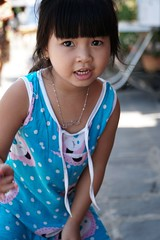 A cute, little Vietnamese girl, Hoi An, Vietnam (adamba100) Tags: asia asian china chinese korea korean mongolia mongolian vietnam vietnamese thai beijing town city view landscape cityscape street life lifestyle style people human person man men woman women male female girl boy child children kid interesting portrait innocent cute charm pretty beauty beautiful innocence play face headshot pure purity tourism sightseeing tourist travel trip light color colour outdoor traditional cambodia cambodian phnom penh sony a6300 18105 siem reap pattaya bangkok field gate architecture tree building