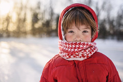 Cold air, just don't care (Elizabeth Sallee Bauer) Tags: active boy bundled child childhood cold fun hat kid outdoors outside playing portrait protectection protection red scarf sled sledding snow white winter wintergear wintersports youth