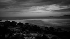 Solitude Exposure - Sony NEX5N + Voigtländer Ultra Wide-Heliar 12mm f/5.6 Aspherical III (Teilor Lopes) Tags: praia siriú garopaba sc santacatarina photography brasil bw wb blackandwhite pb landscape seascape exposure long stone sky sunset