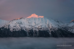 Sitting on the clouds (Traylor Photography) Tags: alaska shadows sunset peak girdwood turnagainarm colors alyeska alpenglow lightsource snow mountain anchorage unitedstates us
