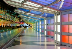 Neon Tunnel (Karen_Chappell) Tags: travel airport building lights people chicago usa architecture blue purple pink green neon ohare