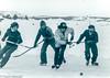 Hockey on Great Slave Lake, Yellowknife, Northwest Territories,  1976 (frankmetcalf) Tags: fmnwt hockey canada northwestterritories yellowknife greatslavelake yellowknifebay winter ice frozen puck stick skates skating snow