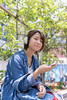 Young woman listening to music on street in Harajuku, Tokyo, Jap (Apricot Cafe) Tags: img36619 asia asianandindianethnicities japan japaneseethnicity shibuyaward sigma35mmf14dghsmart tokyojapan beautifulwoman brownhair buildingexterior candid capitalcities carefree casualclothing charming cheerful citylife colorimage communication connection day enjoyment friendship greencolor happiness harajukudistrict headphones leisureactivity lifestyles listening lookingatcamera music nature oneperson onlyjapanese onlywomen onlyyoungwomen outdoors people photography portrait shopping shoppingbag sitting smiling street student women youngadult