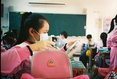 Class Time (issathelakwatsera) Tags: student girl school table bag chalkboard study class taiwan film travel analog analogue konica kodak gc400 35mm people room classroom
