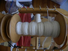 Merino Yarn in Process (MadKnits) Tags: fiber fiberart white red merino spin yarn wool spinningwheel schacht
