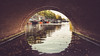 Through the wormhole! (bharathputtur122) Tags: amsterdam tunnel canal paddle boat reflection bricks bridge water boats scenery travel netherlands
