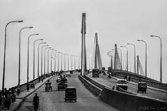The Bridge (Galib Emon) Tags: bridge blackandwhite fineart bangladesh explore flickr canon street people vehicle sky
