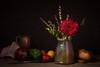 Vivid red flower (Phyllis Freels) Tags: phyllisfreels bread ceramic copper cup flower gerbera greenpepper indoor knife leatherleaf lemon onion red stilllife tabletop tomatoes vase vegetables yellow