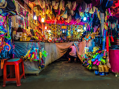 A shop with goods & a hiding shopkeeper (Aranya Ehsan) Tags: travel stret street color colors shop shopkeeper ehsanulsiddiqaranya aranya mobileshot