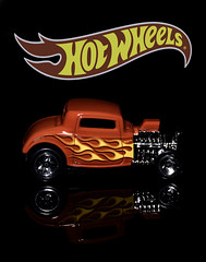 02469376252-97-Hot Wheels 32 Ford Hot Rod-2 (Jim There's things half in shadow and in light) Tags: 32fordhotrod canon5dmarkiv hotwheels tamronsp90mmf28dimacro11vcusd car classiccar closeup flame macro red reflection toy yellow