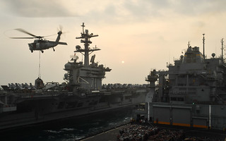 A U.S. Navy aircraft carrier gets replenished at sea.