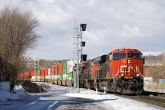 Past the signals (Michael Berry Railfan) Tags: cn canadiannational cn120 train freighttrain intermodaltrain stacktrain cofc sthenri montreal montrealsub quebec winter snow ge generalelectric gevo es44ac cn2903 cn5623 cn2259 sd75i es44dc