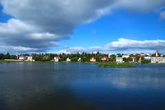 Tjornin Reykjavik Iceland. (Eddie Crutchley) Tags: cruise2017norwayicelandireland europe iceland reykjavik outdoor blueskies lake nature beauty water city simplysuperb greatphotographers
