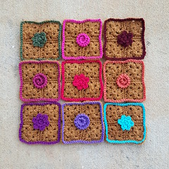 Nine five-inch crochet squares made from an abandoned element of a previous project (crochetbug13) Tags: crochetbug crochet crocheted crocheting crochetsquares grannysquares crochetflowers