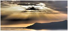 Sunburst (kurtwolf303) Tags: landscape panorama pano santorini sunset sunrays sonnenstrahlen sky clouds wolken dramatic silhouette ocean sea meer mare seascape olympusem5 omd microfourthirds micro43 systemcamera mirrorlesscamera mft kurtwolf303 greece griechenland dämmerung dusk hellas insel island water wasser nature natur sunburst hills contraluz