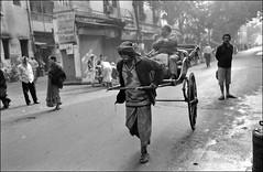 Old Man Pulls Rickshaw (Doctorbabaguy_1) Tags: rickshaw puller man india calcutta kolkata life labor street