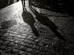 ... (ángel mateo) Tags: ángelmartínmateo ángelmateo granada andalucía españa calle sombras empedrado pareja textura luz andalusia spain street shadows paved couple texture light