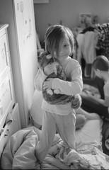 Scan-180114-0027 (Oleg Green (lost)) Tags: portrait bw soul kid daughter light playing toy cat room home family film 35mm fomapan400 rangefinder bessat voigtlander nokton 1550