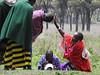 Junior greets senior woman (David Bygott) Tags: africa tanzania natgeoexpeditions 171230 maasai misigiyo nca ngorongoro women greeting