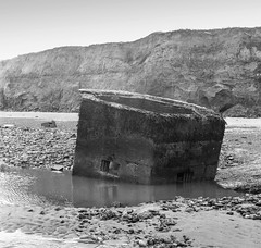 Yashica Pillbox (StuMcP) Tags: happisburgh yashicamat124g ilford400 iso400 film blackandwhite mono square stuartmcpherson upturned splat beach cliff erosion defence ww2