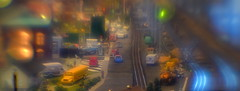 The Belville Yards At Dusk (MPnormaleye) Tags: railroad miniatures transportation tabletop halation glow blur cars buildings track trains model exhibit lensbaby 35mm seeinanewway