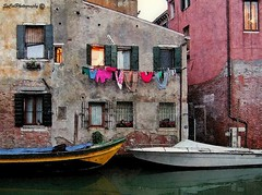 Laundry in Venice (socalgal_64) Tags: carolynlandi venice italy veniceitaly boats gondola old vechio antique colorful landscape water canal architecture structures buildings laundry