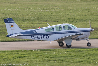D-ETFD - 1990 build Beech F33A Bonanza, taxiing for departure on Runway 24 at Friedrichshafen during Aero 2017